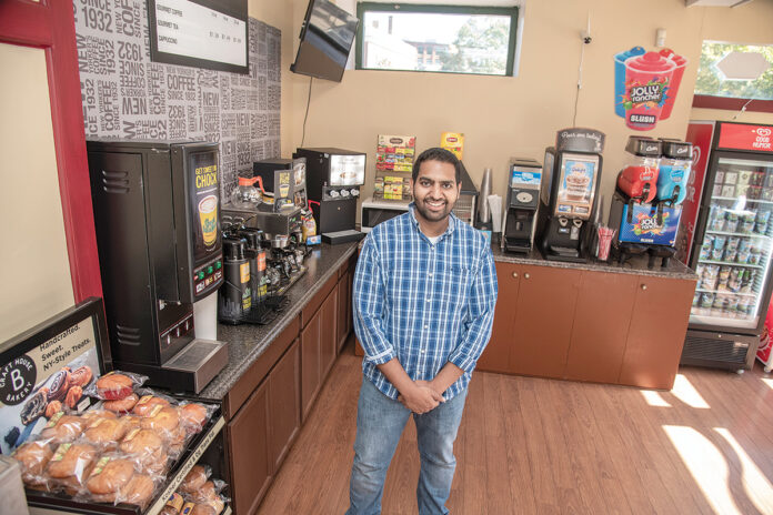 NEW MARKET: Hassan Namat-Ullah is a co-owner of the new University Mart on Empire Street in Providence. The market features snack foods, bottled soda, milk and some perishables, as well as CBD products and a Bitcoin machine.