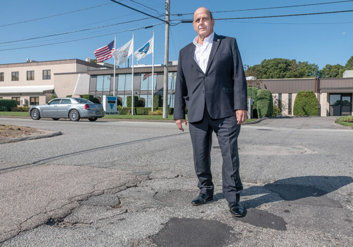 PROACTIVE APPROACH: ­Warwick Mayor Joseph J. Solomon stands on New England Way at the intersection of Gilbane Street. Both roads are on the schedule to be repaved. Solomon said roadwork has been a priority since he took office in spring 2018. He says last year was the first time in 20 years the city has implemented a proactive program.