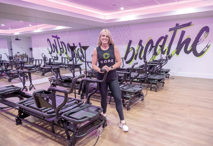 GOOD FIT: Denise Chakoian is the owner of CORE Cycle.Fitness.Lagree, a boutique studio in Wayland Square in Providence. The studio opened in July after Chakoian decided to consolidate her fitness business while she was getting treatment for Hodgkin's lymphoma. / PBN PHOTO/MICHAEL SALERNO