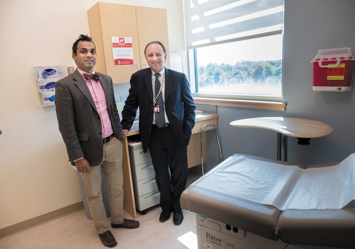 FRUSTRATION FACTOR: Brown Medicine rheumatologist Dr. Deepan Dalal, left, and David Hemendinger, the practice's chief information officer, say the time-consuming process of filling out electronic medical records might be contributing to physician burnout. / PBN PHOTO/MICHAEL SALERNO