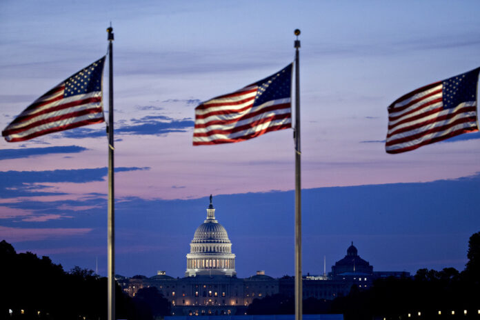 THE U.S. BUDGET DEFICIT 26% to $984 billion in 12 months through September. / BLOOMBERG FILE PHOTO/ANDREW HARRER