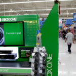 CITIZENS BANK announced a partnership with software giant Microsoft and online retail giant Amazon to provide no-interest financing for consumers wanting to buy the Xbox All Access program. Shown here is an Xbox One video game console at a Wal-Mart store in Los Angeles / BLOOMBERG NEWS FILE PHOTO/PATRICK T. FALLON