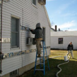 ENERGY EFFICIENCY: Rhode Island ranked third in the nation this year in energy efficiency. That included efforts like the more than 2,100 Rhode Island homeowners who have taken advantage of National Grid's Heat Loan Program, which offers zero-interest loans to residential property owners for qualifying energy-efficiency improvements. Above, insulation is blown into the walls of a house. / COURTESY NATIONAL GRID