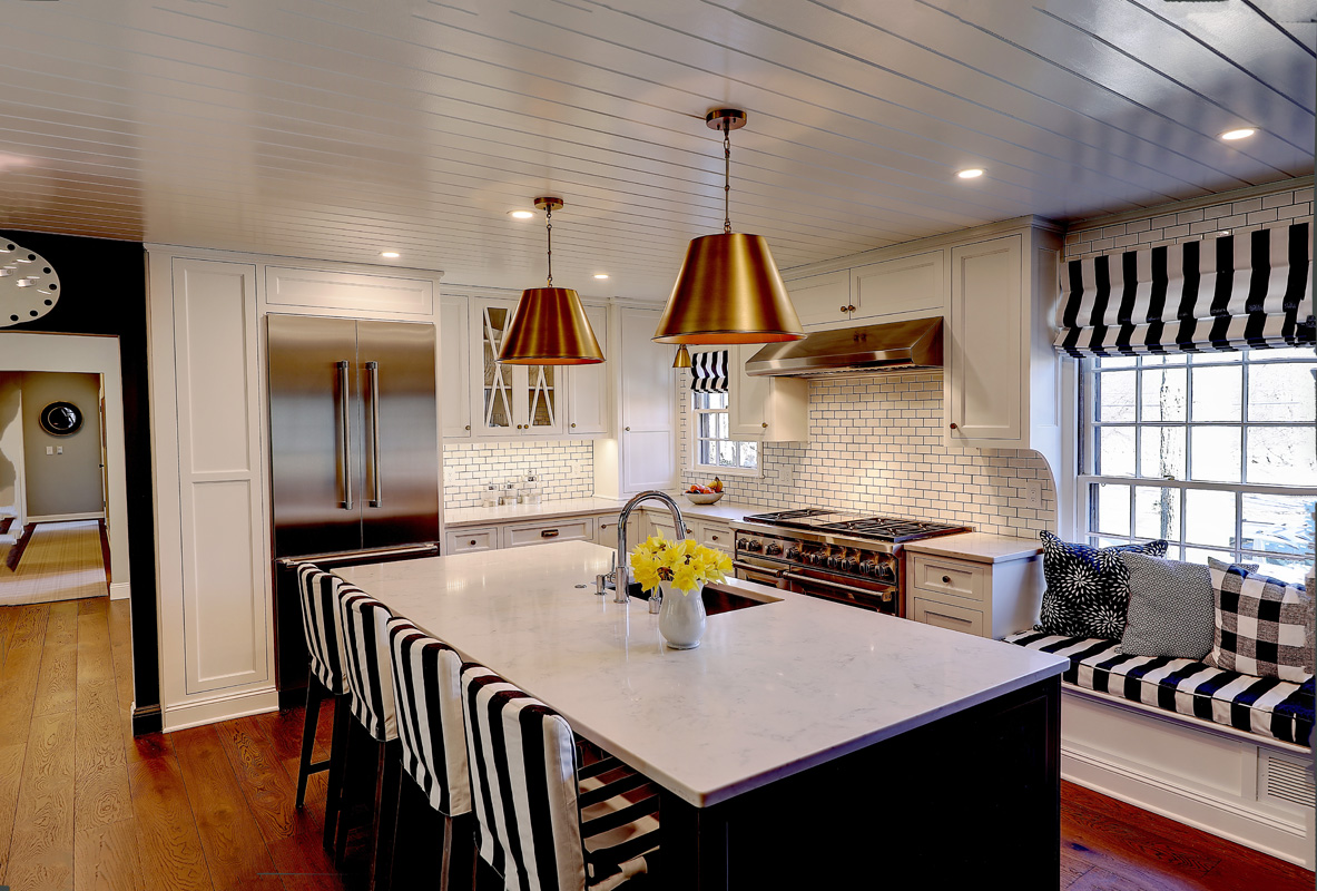 THE RECENTLY renovated home has a chef's kitchen. THE HOME has a front to back living room. / COURTESY RESIDENTIAL PROPERTIES LTD.