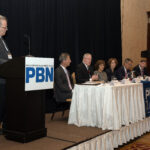 PROVIDENCE BUSINESS NEWS EDITOR Mike Mello, left, leads the discussion at PBN's Health Care Summit on Wednesday. Participating on the panel are, from left, Marc Backon, president, commercial division, at Tufts Health Plan; Stephen Farrell, CEO of UnitedHealthcare of New England; Marie L. Ganim, R.I. Health Insurance Commissioner, Kim A. Keck, CEO and president of Blue Cross & Blue Shield of Rhode Island; Dr. Alan Kurose, CEO and president of Coastal Medical; and Neil D. Steinberg, CEO and president of Rhode Island Foundation. / PBN PHOTO/MIKE SKORSKI