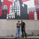"AS220 FOUNDER Umberto ""Bert"" Crenca, left, stands with artist Shepard Fairey in front of Shepard's ""Providence Industrial"" mural that he designed to coincide with AS220's 25th anniversary in 2010. COURTESY AS220/LINDA KING"