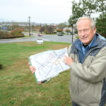 STANDSTILL: John Hirschboeck, co-president of community nonprofit Alliance for a Livable Newport, argued for a six-month development moratorium in the city's North End. He and other supporters say the city needs time to develop zoning requirements for the area, shown on the map he's holding. / PBN PHOTO/DAVE HANSEN