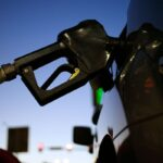 THE AVERAGE PRICE of regular gas in Rhode Island declined 2 cents from last week to $2.49 per gallon. / BLOOMBERG NEWS FILE PHOTO/LUKE SHARRETT