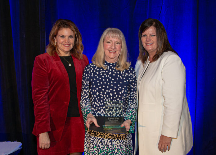 KRISTEN ADAMO, left, and Kimberly Greene, right, induct Karen Silva, department chair of graduate business programs at Johnson & Wales University, into the PWCVB Hall of Fame. / PROVIDENCE WARWICK CONVENTION & VISITORS BUREAU