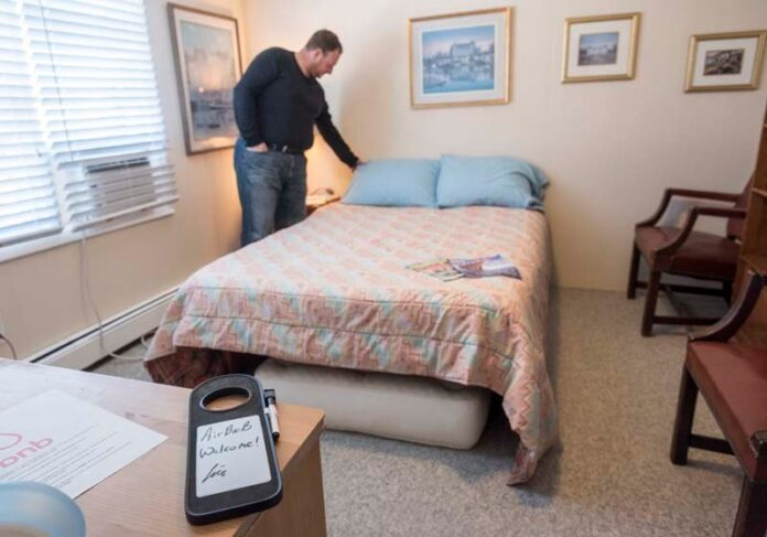 A NEW short-term rental ordinance in Providence is slated to take effect at the end of the month. Above Eric Weiner, shown in 2017, an Airbnb host who rented out rooms in his Providence house. / PBN FILE PHOTO/ MICHAEL SALERNO