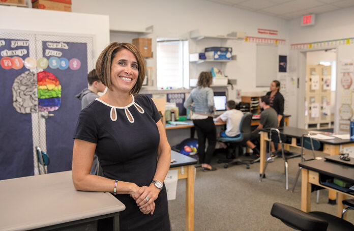 TEAM LEADER: Anna Johnson, head of school at The Wolf School in East Providence, says a team of teachers and therapists is assigned to classrooms to help students. / PBN PHOTO/TRACY JENKINS