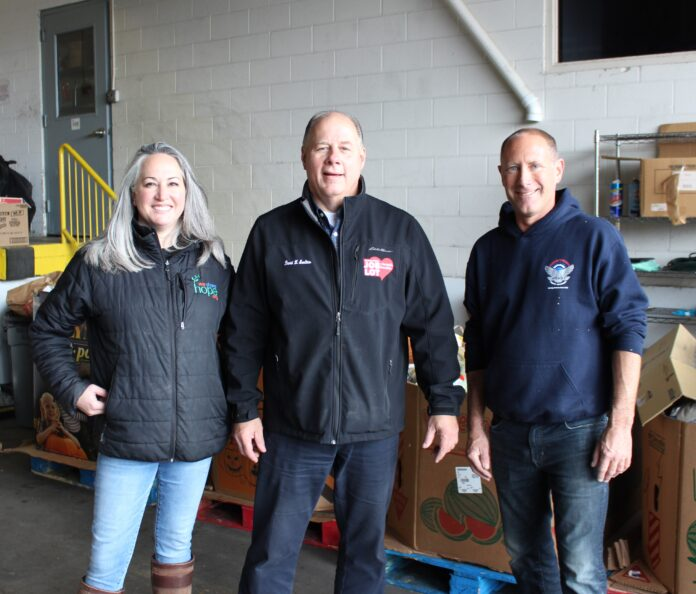 THE FILL-A-BUS food drive raised more than 25,000 pounds of food this year. Above, Cristina McKibbin, chief operating officer, We Share Hope; David Sarlitto, executive director, Ocean State Job Lot Charitable Foundation; and Erik Wallin, executive director, Operation Stand Down Rhode Island. / COURTESY OCEAN STATE JOB LOT