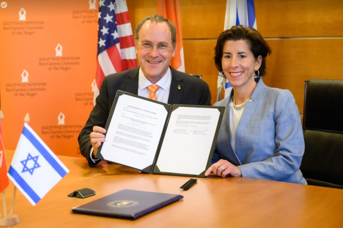 BEN-GURION University of the Negev President Daniel Chamovitz and Gov. Gina M. Raimondo sign a memorandum of understanding in Beer-Sheva, Israel, on Tuesday. / COURTESY A.L. COMMUNICATIONS