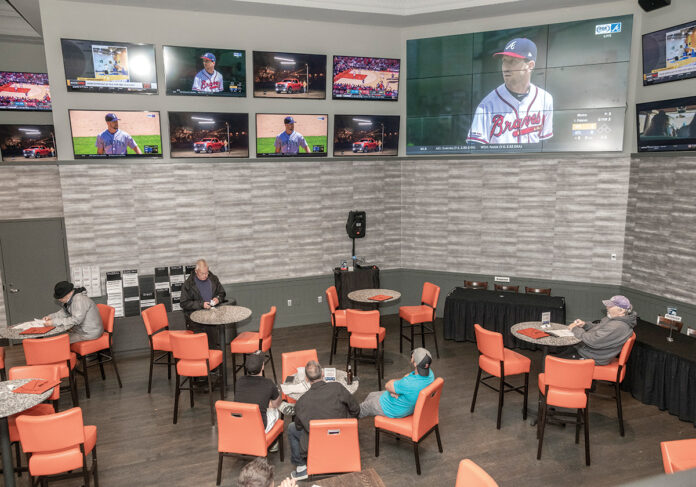 MORE STATES are expected to take on the debate over legalizing sports gambling in 2020. Above, the sports betting lounge at Twin River Casino Hotel. / PBN FILE PHOTO/MICHAEL SALERNO