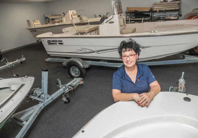 MAKING WAVES: Debbie A. Wood, president and co-owner of Wood Boat & Motor Inc. in Warwick, decided with her husband, Russell, to take over running the Providence Boat Show, which has been rebranded the Rhode Island Boat Show, after the previous organizers stepped down after three decades at the helm. / PBN PHOTO/MICHAEL SALERNO