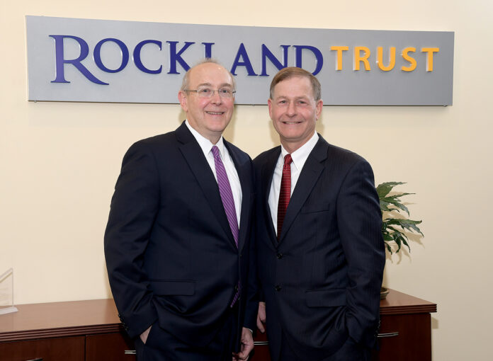 READY TO AID: Gary Friedmann, left, vice president and portfolio manager for Rockland Trust Co., and Larry Wagner, Rockland Trust vice president and financial consultant, advise 401(k) participants to try to limit emotional decision-making when it comes to retirement savings. / PBN PHOTO/MIKE SKORSKI