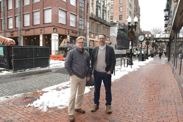 TAKING SHAPE: Architects Donald Powers, left, and Douglas Kallfelz, of Union Studio Architecture & Community Design, outside a three-building project the firm designed on Westminster Street in Providence. / PBN PHOTO/MIKE SKORSKI