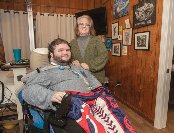 SOME GOOD NEWS: Lee-Ann Quinn's son, Zach, just turned 21 and his family learned recently that the state will continue to cover the nursing care that he needs to stay at home. About 15 other families are waiting for word on similar benefits for children who've recently aged out of pediatric benefits. / PBN PHOTO/MICHAEL SALERNO