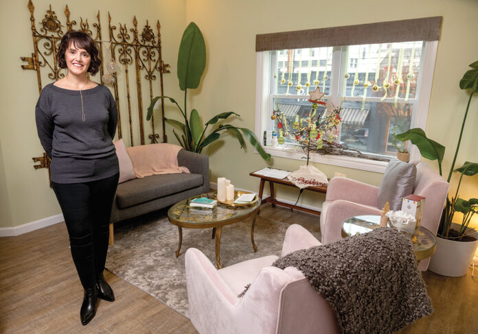 "NEEDED TREATMENT: Susan Benzuly, owner of Evolve Apothecary and Spa in Providence, says selling spa time to customers who are giving the treatments as gifts has become a key part of her business during the holidays. ""Self-care is not a luxury; it is a necessity,"" she said. / PBN PHOTO/MICHAEL SALERNO"
