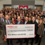 THE CVS HEALTH Charity Classic raised $1 million dollar for 86 nonprofits. In the foreground, from the left, event co-host Brad Faxon, CVS Health President and CEO Larry Merlo and event co-host Billy Andrade are joined by dozens of charitable partners whose organizations are the recipients of a $1 million dollar donation generated by the annual golf event. / COURTESY CVS HEALTH