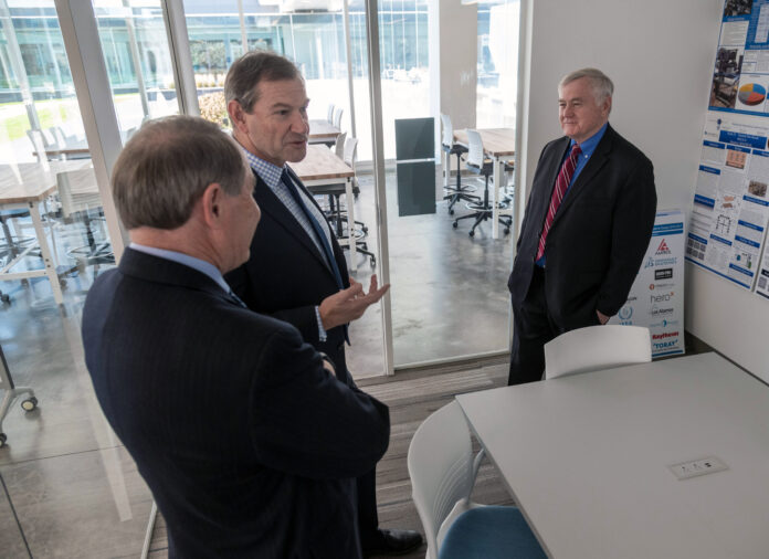 HEXAGON MANUFACTURING INTELLIGENCE has made a $4 million gift to URI in the form of manufacturing technology and assistance. Above, from left to right,URI President David M. Dooley, Hexagon's President and CEO Angus Taylor, and URI Dean of Engineering Ray Wright. / COURTESY UNIVERSITY OF RHODE ISLAND/MICHAEL SALERNO