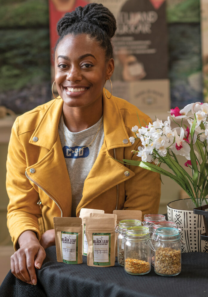TEA IT UP: Amber Jackson with some of the products available through her business, Black Leaf Tea and Culture Shop. / PBN PHOTO/MICHAEL SALERNO