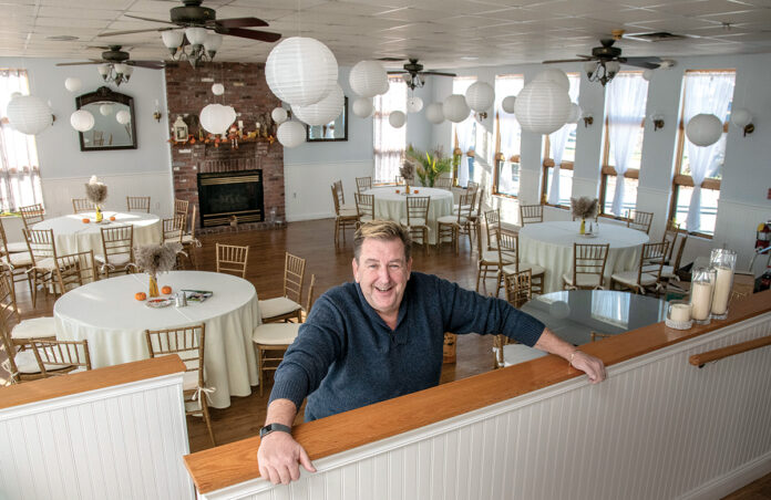 IN ANY EVENT: Mark Brown, co-owner of Cozy Caterers, stands in one of the party spaces available at the Warwick venue where the catering company relocated last May. / PBN PHOTO/MICHAEL SALERNO
