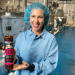 A TALL DRINK: Anna Scott, owner of Anna's Kitchen Shrub, produces a beverage known as shrub that is made of apple cider vinegar at a facility in Lincoln. The drink has become popular in mocktails and low-alcohol cocktails. / PBN PHOTO/MICHAEL SALERNO